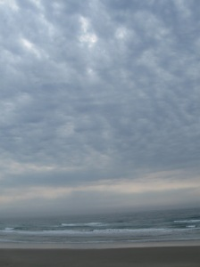 The overcast afternoon sky as the sun tries to peek out.