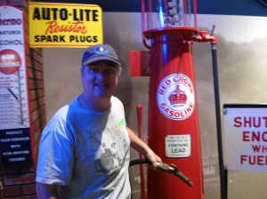 Mike by an old gas pump.  The artifacts are in pristine condition.